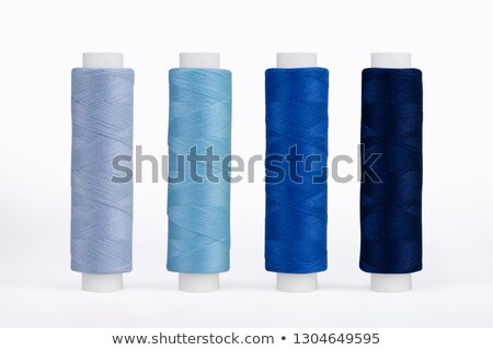 bobbin of blue thread isolated on the background Stock photo © tetkoren