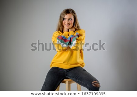 Pretty woman in yellow blouse isolated on white Stock photo © Elnur