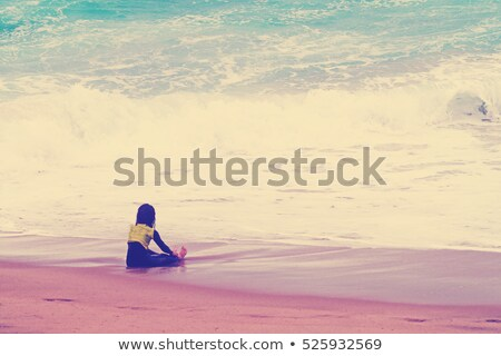 little girl sits ashore in waves Stock photo © Paha_L