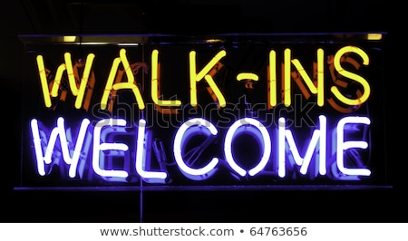 white glowing neon welcome sign stock photo © voysla