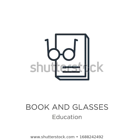 calculator and glasses on opening textbook stock photo © paha_l