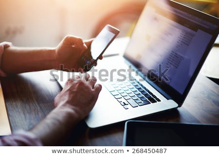 Businessman using mobile phone at office desk Stock photo © stevanovicigor
