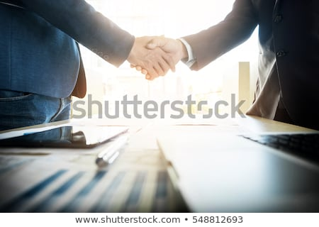 Dois empresário apertar a mão um ocultação arma Foto stock © ra2studio