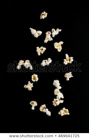 popcorn · isolato · nero · sale · texture · piatto - foto d'archivio © mady70