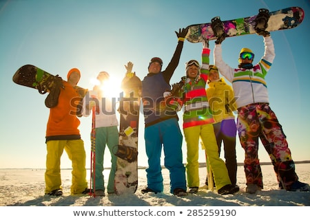 Genç kadın rahatlatıcı alpine Kayak başvurmak oturma Stok fotoğraf © dash