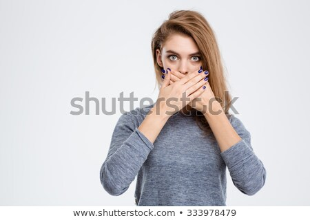 Amazed woman covering her mouth with palms Stock photo © deandrobot