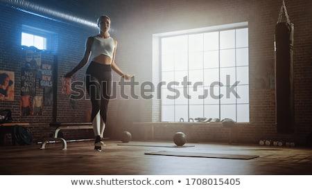 blonde jumps with skipping rope stock photo © bezikus
