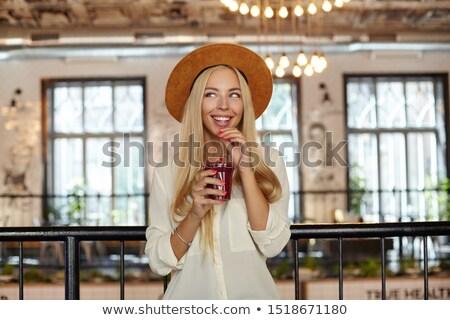 Mulher jovem longo cabelo loiro em pé ao ar livre mulher Foto stock © deandrobot