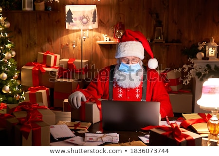 Papá noel de trabajo ordenador abierto portátil blanco Foto stock © -Baks-