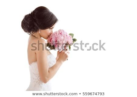 3a0457f9d3225a Beautiful bride. Wedding hairstyle make-up luxury fashion dress ...