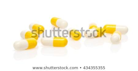 Сток-фото: Capsule Yellow White