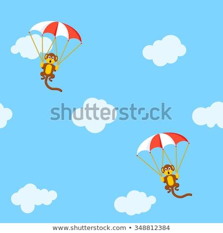 Monkeys with parachutes in the sky Stock photo © SwillSkill