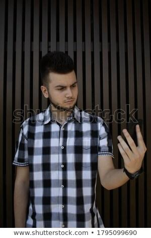 sakallı · adam · bakıyor · ayna · takım · elbise · erkekler - stok fotoğraf © deandrobot