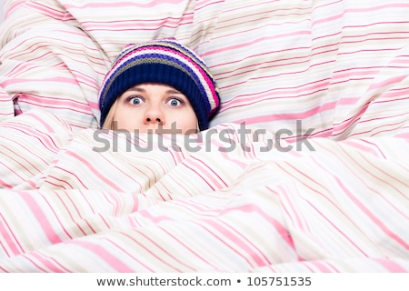 Funny young woman in hat covered in blanket Stock photo © deandrobot