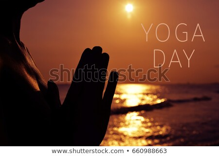 man with his hands put together and text yoga day stock photo © nito