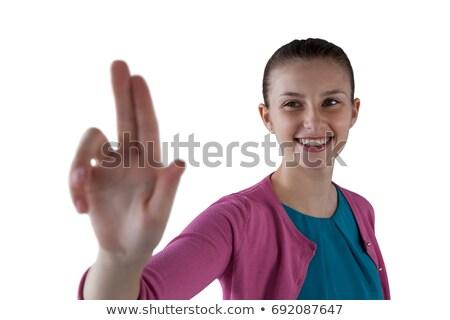 Smiling teenage girl pressing an invisible virtual screen Stock photo © wavebreak_media