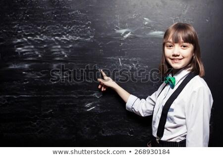 student girl near blackboard stock photo © anna_om