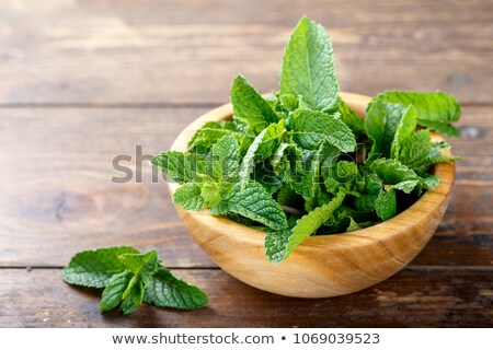 Fresh mint on wooden background Stock photo © yelenayemchuk