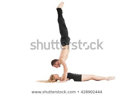 Man in handstand above woman lying Stock photo © julenochek