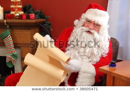 Kerstman schrijven scroll woonkamer home man Stockfoto © wavebreak_media