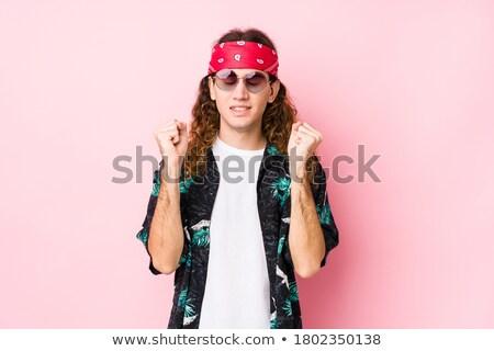 Caucasian hippie man standing with raised arms. Stock photo © RAStudio