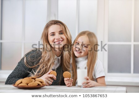 girl and younger sister eating Stock photo © IS2