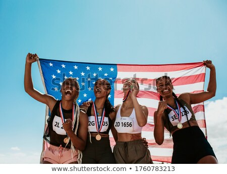 relay team with flag and medal Stock photo © IS2