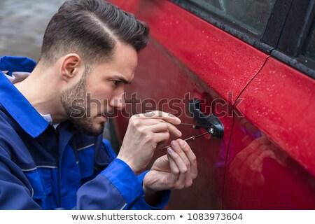 Emberi kéz nyitás autók ajtó közelkép piros Stock fotó © AndreyPopov
