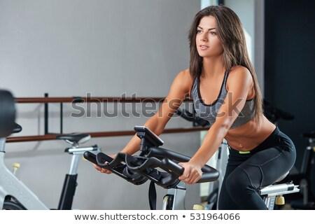 młoda · kobieta · posiedzenia · wykonywania · równoważenie · poduszka · salon - zdjęcia stock © is2