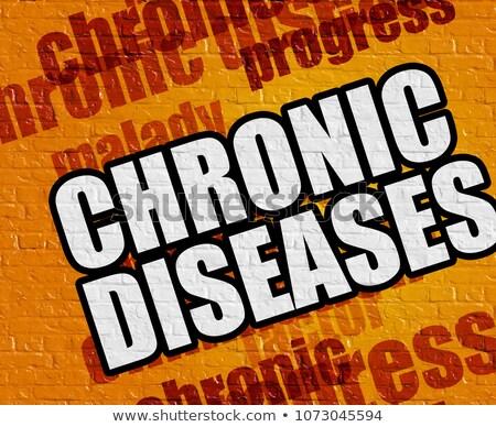 modern health concept chronic diseases on the yellow brickwall stock photo © tashatuvango