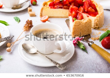 Cup of cooffee and strawberry cheesecake Stock photo © Melnyk