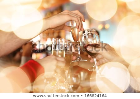 champagne glasses in hands on golden background stock photo © dashapetrenko