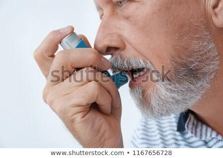 Uomo asma primo piano senior mano faccia Foto d'archivio © AndreyPopov