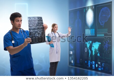 doctor looking at x ray image in telehealth concept stock photo © elnur