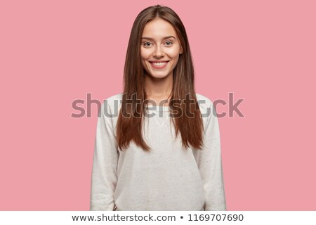 Portrait of a delighted young woman dressed in sweater Stock photo © deandrobot
