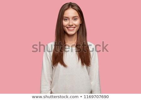 Portré elragadtatott fiatal nő pulóver áll izolált Stock fotó © deandrobot