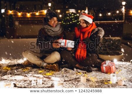 opgewonden · jonge · vrouw · vergadering · buitenshuis · avond · christmas - stockfoto © deandrobot