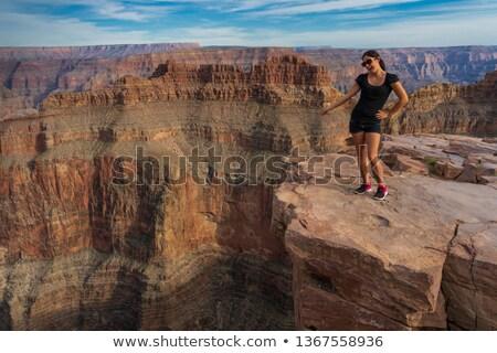 couple with backpacks over grand canyon Stock photo © dolgachov