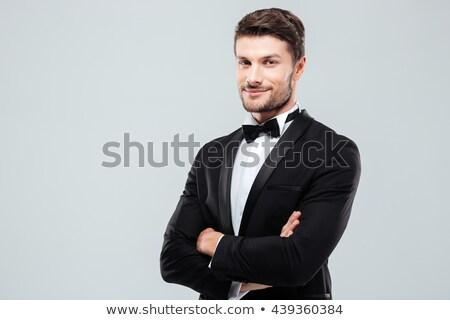 Glimlachend bruidegom zwarte smoking permanente armen Stockfoto © feedough