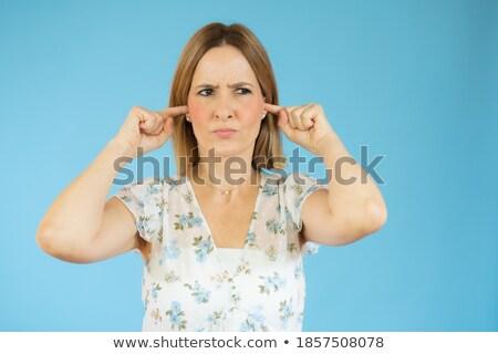 Elégedetlen fiatal nő pózol izolált kék fal Stock fotó © deandrobot