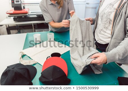 Team in advertising agency discussing which items to use in promotion Stock photo © Kzenon