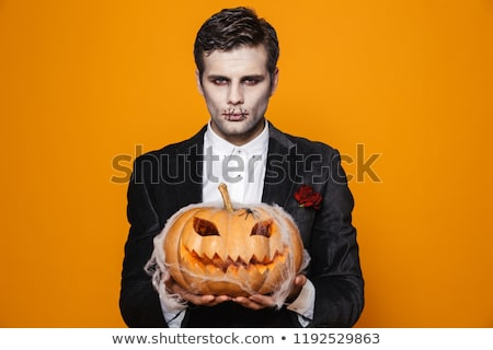 Photo of scary zombie man on halloween wearing classical suit an Stock photo © deandrobot