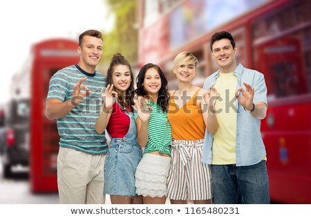 happy friends showing ok over london city street Stock photo © dolgachov