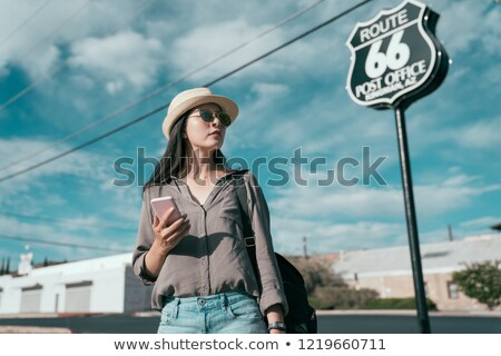 teenage girl in phones with smartphone on route 66 Stock photo © dolgachov