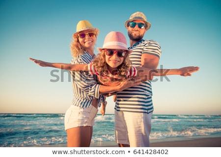 Happy family on the beach. People having fun on summer vacation. Stock photo © dashapetrenko
