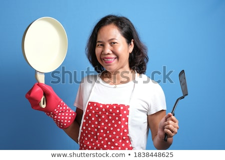 Cheerful chef cook wearing uniform showing frying pan Stock photo © deandrobot