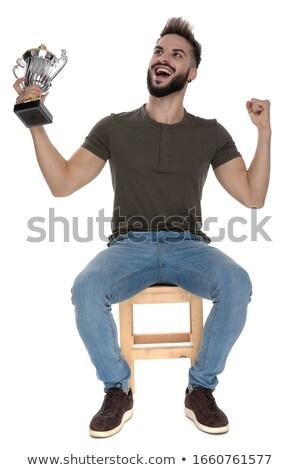 Hombre sesión silla gritando trofeo taza Foto stock © feedough