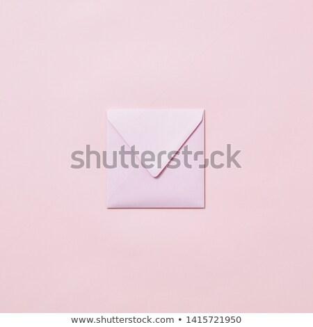 Handcraft envelope mockup for post card on a pastel pink background. Stock photo © artjazz