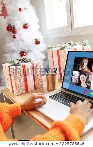 friends celebrating christmas and speaking toast stock photo © dolgachov