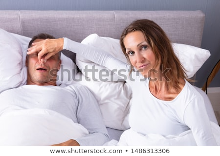 Woman Holding Her Husband's Nose To Stop Him From Snoring Stock photo © AndreyPopov
